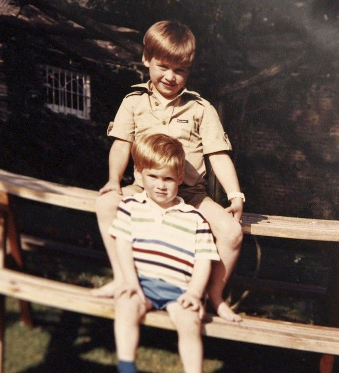 In this photo made available by Kensington Palace from the personal photo album of the late Diana, Princess of Wales, Prince William and Prince Harry sit on a picnic bench together and  features in the new ITV documentary 'Diana, Our Mother: Her Life and Legacy.' Prince William and Prince Harry will pay tribute to their mother, Princess Diana, as the 20th anniversary of her death in a car crash approaches in a TV documentary Diana, Our Mother: Her Life and Legacy which will air Monday July 24, 2017 on British TV. (The Duke of Cambridge and Prince Harry/Kensington Palace via AP)  NO USE ON THE FRONT COVERS OF ANY UK OR INTERNATIONAL MAGAZINES. NO COMMERCIAL USE (including any use in merchandising, advertising or any other non-editorial use including, for example, calendars, books and supplements).
