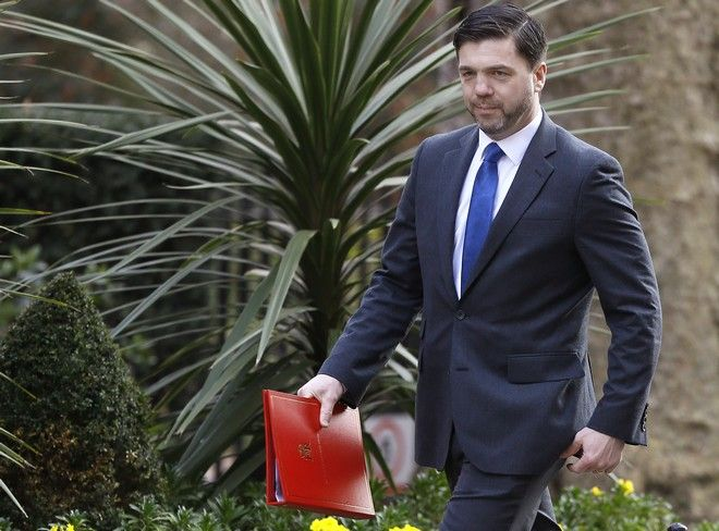 Britain's new Work and Pensions Secretary Stephen Crabb arrives for a cabinet meeting at Downing Street in London, Tuesday, March 22, 2016. Later Tuesday in Britain's Parliament MP's will vote on whether to approve Britain's Chancellor George Osborne's Budget. (AP Photo/Kirsty Wigglesworth)