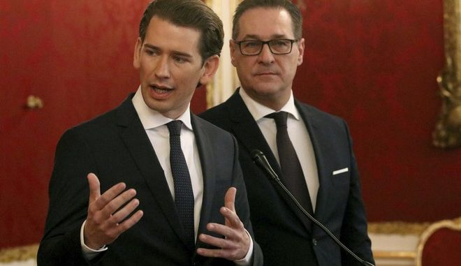 Foreign Minister and leader of the Austrian People's Party, OEVP, Sebastian Kurz and Heinz-Christian Strache,  chairman of the right-wing Freedom Party, FPOE, from left, talk to press after talks with Austrian President Alexander van der Bellen for forming a new coalition government at the Hofburg palace in Vienna, Austria, Saturday, Dec. 16, 2017. (AP Photo/Ronald Zak)