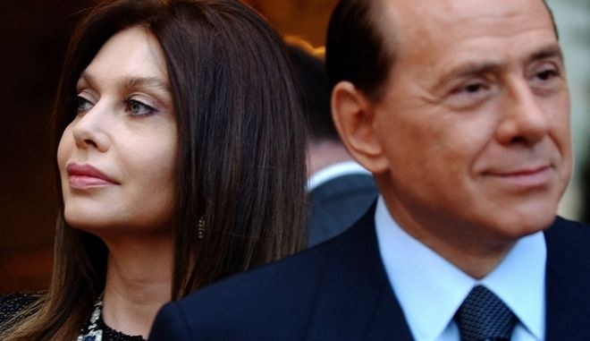 FILE - In this Friday June 24, 2004 file photo, Italian premier Silvio Berlusconi, right, and his wife Veronica Lario wait for President George W. Bush and first lady Laura Bush at the Villa Madama residence in Rome. An Italian newspaper has reported, Friday, Dec. 28, 2012, the details of the divorce settlement between ex-Premier Silvio Berlusconi and his second wife Veronica Lario, saying he must pay her 3 million ($4 million) a month alimony but gets to keep their estate. Lario announced she was divorcing the billionaire media mogul in 2009, citing his presence at the 18th birthday party of a Naples girl and his fondness for younger women. The couple met in a dressing room in 1980 after Berlusconi saw Lario perform in a Milan theater, were married in 1990 and have three grown children. He has two children from his first marriage. The 76-year-old Berlusconi is currently dating a woman nearly 50 years his junior. (AP Photo/Susan Walsh, File)