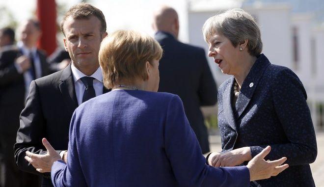 Η γερμανίδα καγκελάριος Άνγκελα Μέρκελ, ο γάλλος πρόεδρος Εμανουέλ Μακρόν και η βρετανίδα πρωθυπουργός Τερέζα Μέι
