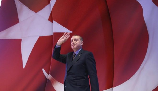 In this late Wednesday, April 12, 2017 photo, Turkey's President Recep Tayyip Erdogan addresses his supporters during a referendum meeting in Istanbul. Turkey is heading to a contentious April 16 referendum on constitutional reforms to expand Erdogan's powers.(Kayhan Ozer/Presidential Press Service, Pool Photo via AP)