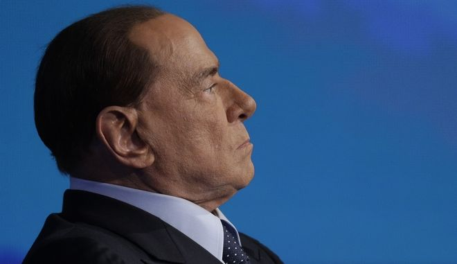 Italian former Prime Minister and Forza Italia (Go Italy) party leader, Silvio Berlusconi, takes part at the Italian state television RAI, Porta a Porta,(Door To Door) talk show in Rome, Thursday, Jan. 11, 2018. (AP Photo/Andrew Medichini)
