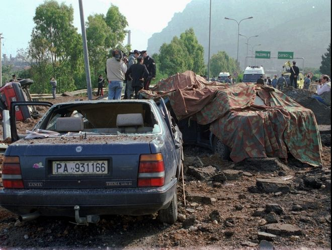 FILE - This May 23, 1992 file photo shows the scene on the highway near the Sicilian town of Palermo, southern Italy, after a powerful bomb killed anti-Mafia magistrate Giovanni Falcone, his wife and three bodyguards. Italian media reported Friday, Nov. 17, 2017 that Mafia boss Salvatore 'Toto' Riina died at the age of 87 in the hospital while serving multiple life sentences as the mastermind of a bloody strategy to assassinate Italian prosecutors and law enforcement trying to bring down the Cosa Nostra.   (AP Photo/Bruno Mosconi, files)