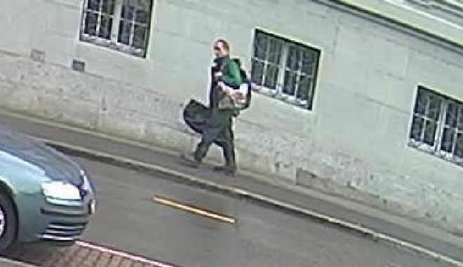 This undated photo provided by the Schaffhauser Polizei shows the suspect in a chainsaw attack in Schaffhausen, Switzerland on Monday. The man suspected of wounding five people with a chainsaw was still on the loose Tuesday, July, 25, 2017 and a massive manhunt was taking place on the Swiss-German border. (Schaffhauser Polizei via AP)