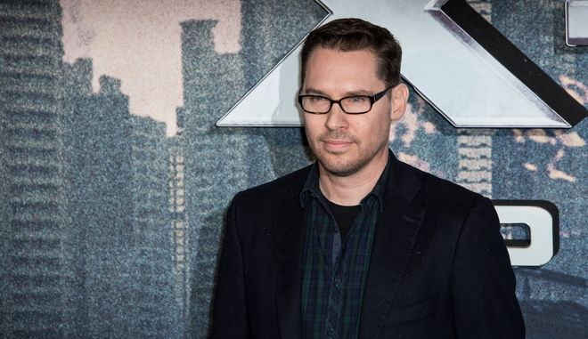 Director Bryan Singer poses for photographers upon arrival at the screening of the film 'X-Men Apocalypse' in London, Monday, May 9, 2016. (Photo by Vianney Le Caer/Invision/AP)