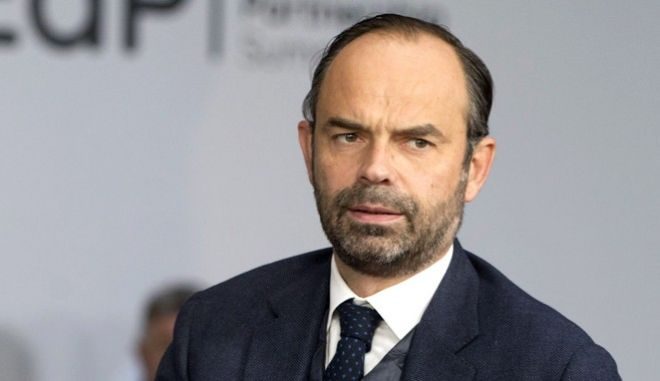 FILE - In this Friday, Nov. 24, 2017 file photo, French Prime Minister Edouard Philippe arrives for an Eastern Partnership Summit in Brussels. French Prime Minister Edouard Philippe says he will assume responsibility for spending 350,000 euros ($414,000) on a private flight back from a French territory in the South Pacific. (AP Photo/Virginia Mayo, Pool, File)
