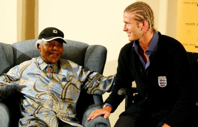 Former South African President Nelson Mandela chats with England soccer captain David Beckham at Nelson Mandela's Foundation office in Johannesburg May 21,2003. England will play a friendly match against South Africa in Durban tommorrow. REUTERS/Juda Ngwenya   PP03090058  JN/JV - RTR13N0I