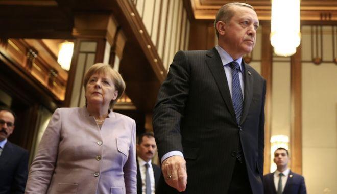 German Chancellor Angela Merkel, left, and Turkish President Recep Tayyip Erdogan arrive for a press statement after a meeting in Ankara, Turkey, Thursday, Feb. 2, 2017. (AP Photo/Lefteris Pitarakis)