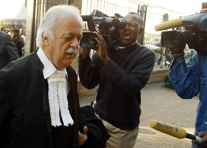 Legal advisor to former President Nelson Mandela,  George Bizos,  arrives at the High Court in Johannesburg, Tuesday May 31, 2005. A judge ordered art dealer Ross Calder, and Mandela's former lawyer, Ismail Ayob, to stop selling artworks bearing Mandela's signature. (AP Photo)