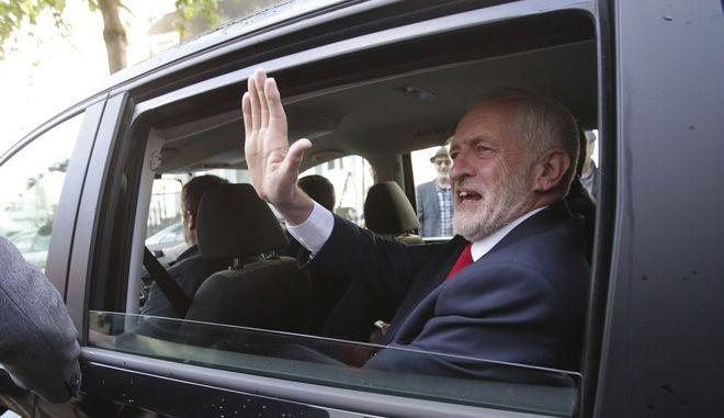 Labour leader Jeremy Corbyn waves as he leaves his home in north London, Friday June 9, 2017. British Prime Minister Theresa May's gamble in calling an early general election backfired spectacularly, as her Conservative Party lost its majority in Parliament and pressure mounted on her Friday to resign.  (Yui Mok/PA via AP)
