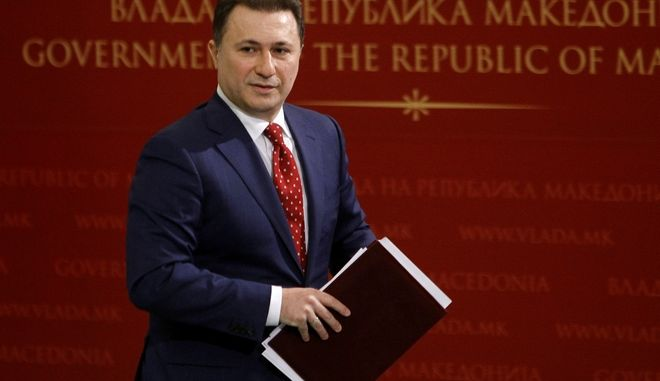 "Macedonian Prime Minister Nikola Gruevski leaves after a news conference in the government building in Skopje, Macedonia, Wednesday, Feb. 25, 2015.  Gruevski  has immediately dismissed claims of illegal wire-tapping made by opposition leader Zoran Zaev and has reiterated the previous accusation that Zaev was plotting to overthrow the government in collaboration with unidentified ""foreign services"". (AP Photo/Boris Grdanoski)"