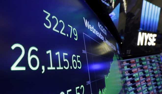 A screen above the trading floor of the New York Stock Exchange shows the closing number of the Dow Jones industrial average, Wednesday, Jan. 17, 2018. Stocks are closing higher on Wall Street, sending the DJIA to its first close above 26,000 points. (AP Photo/Richard Drew)