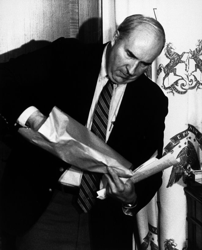 Pennsylvania state treasurer R. Budd Dwyer prepares to pull a pistol from a brown manila envelope during a news conference in his State Capitol office in Harrisburg, Penn., Jan. 22, 1987. Dwyer inserted the pistol barrel into his mouth and pulled the trigger, committing suicide in front of newsmen. (AP Photo/Paul Vathis)