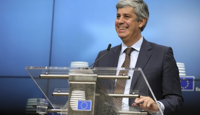 Portugal's Finance Minister Mario Centeno speaks during a media conference after a meeting of eurozone finance ministers at the Europa building in Brussels on Monday, Dec. 4, 2017. Eurozone finance ministers met Monday to elect a new president for the club of 19 nations that share the euro currency. (AP Photo/Olivier Matthys)