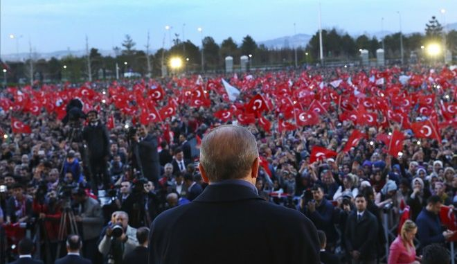 Turkey's President Recep Tayyip Erdogan delivers a speech during a rally a day after the referendum, outside the Presidential Palace, in Ankara, Turkey, Monday, April 17, 2017. Turkey's main opposition party urged the country's electoral board Monday to cancel the results of a landmark referendum that granted sweeping new powers to Erdogan, citing what it called substantial voting irregularities. (Press Presidency Press Service via AP, Pool)
