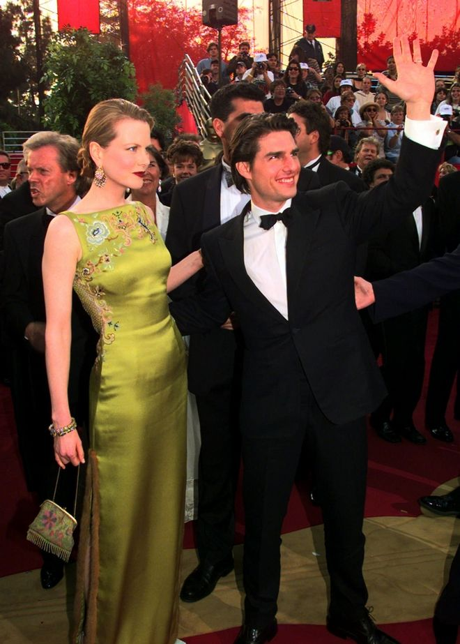 Tom Cruise and Nicole Kidman smile as they arrive for the 69th Annual Academy Awards at the Shrine Auditorium in Los Angeles, Monday, March 24, 1997. (AP Photo/Chris Pizzello)