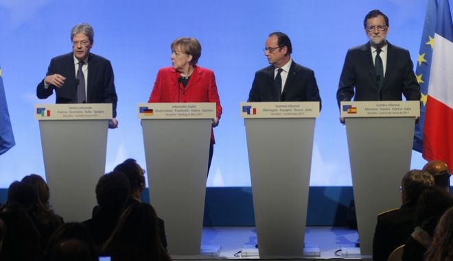 France's President Francois Hollande, welcomes Spain's Prime Minister Mariano Rajoy Brey, German Chancellor Angela Merkel, Italian Prime Minister Paolo Gentiloni at the Versailles castle, near Paris, France, Monday, March 6, 2017. Hollande is hosting German Chancellor Angela Merkel, Spanish Prime Minister Mariano Rajoy and Italian Prime Minister Paolo Gentiloni in Versailles to prepare for a larger EU meeting later this week. (AP Photo/Michel Euler)