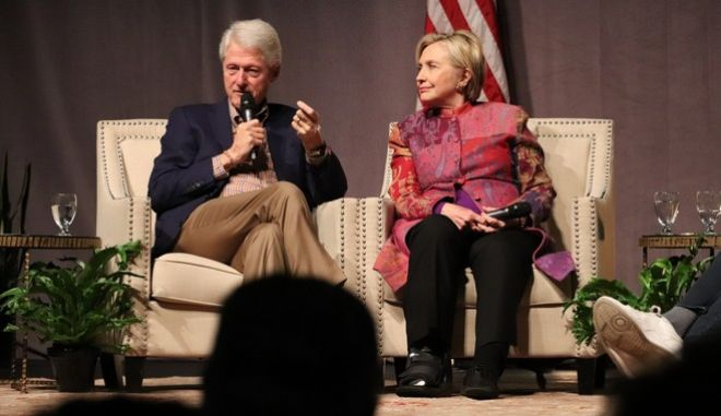 Accompanied by his wife, Hillary Clinton, former President Bill Clinton speaks at a gathering in Little Rock, Ark., on Saturday, Nov. 18, 2017, marking 25 years since his election. (AP Photo/Kelly P. Kissel)