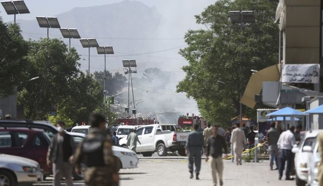 Security forces inspect near the site of an explosion in Kabul, Afghanistan, Wednesday, May 31, 2017.  A massive explosion rocked a highly secure diplomatic area of Kabul on Wednesday morning, causing casualties and sending a huge plume of smoke over the Afghan capital. (AP Photos/Massoud Hossaini)