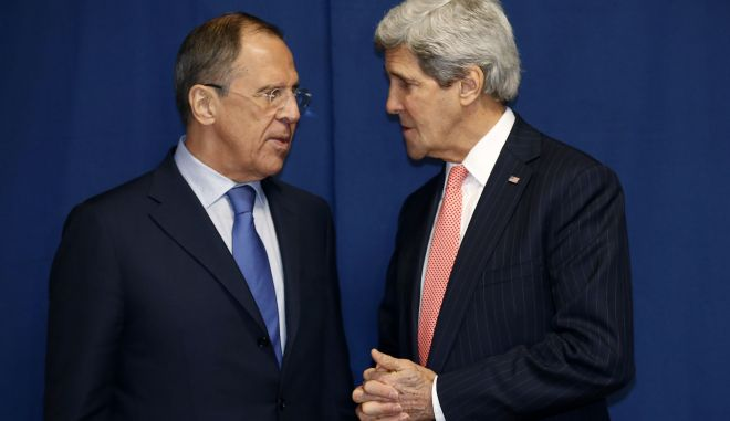 Secretary of State John Kerry talks with Russian Foreign Minister Sergey Lavrov during a meeting to discuss the Ukraine crisis, Thursday, March 6, 2014, at the Conference on International Support to Libya, in Rome. It is the second meeting in as many days between Kerry and Lavrov, who met in Paris on Wednesday to talk about the crisis over the crisis in Ukraine's Crimea Peninsula. (AP Photo/Kevin Lamarque, Pool)