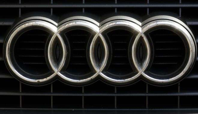 The brand logo of German car maker Audi is photographed on a car in Berlin, Tuesday, Aug. 1, 2017. German Transport Minister Alexander Dobrindt and Environment Minister Barbara Hendricks call the leaders of German car makers for a meeting named National Diesel Forum to Berlin on Wednesday, Aug. 3, 2017. (AP Photo/Markus Schreiber)