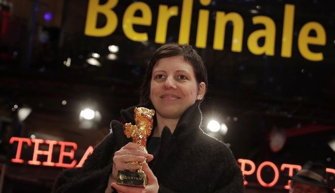 Director and screenwriter Adina Pintilie holds the golden bear for the best movie for her film 'Touch me not' after the awarding ceremony of the 68th edition of the International Film Festival Berlin, Berlinale, in Berlin, Germany, Saturday, Feb. 24, 2018. (AP Photo/Markus Schreiber)