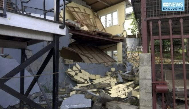 FILE - This file image made from video provided Feb. 28, 2018, show the damaged building following an earthquake in Mendi, Papua New Guinea. At least 55 people have been confirmed dead and authorities fear the toll could exceed 100 from last week's powerful earthquake in Papua New Guinea, as survivors faced more shaking early Wednesday,March 7, 2018 from the strongest aftershock so far. (Australia Broadcasting Corporation via AP, File)