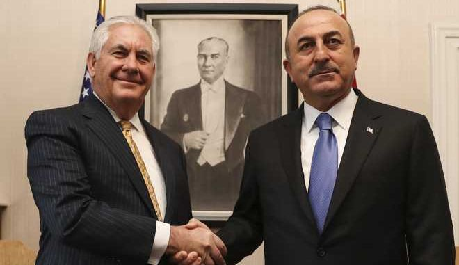 "Turkey's Foreign Minister Mevlut Cavusoglu, right, shakes hands with U.S. Secretary of State Rex Tillerson, left, prior to their meeting in Ankara, Turkey, Friday, Feb. 16, 2018. The visit came as Ankara is riled over Washington's support for the Syrian Kurdish People's Protection Units, or YPG _ the top U.S. ally in the anti-IS fight. Turkey considers the YPG a ""terrorist"" group linked to Kurdish insurgents within Turkey. (Anadolu via AP, Pool)"