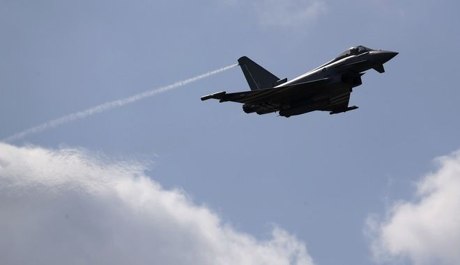 A Eurofighter Typhoon flies on display during Farnborough International Air Show, Farnborough, England, Tuesday, July 15, 2014. (AP Photo/Sang Tan)