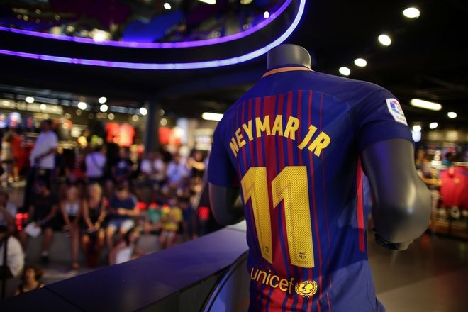 A t-shirt with the name of FC Barcelona's Neymar is displayed in a store of the Camp Nou stadium in Barcelona, Spain, Wednesday, Aug. 2, 2017. Neymar has told Barcelona that he plans to leave the club, with a blockbuster move to Paris Saint-Germain seemingly imminent. (AP Photo/Manu Fernandez)
