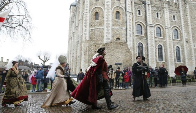 Historical interpreters reenact a Christmas walk by England's King Richard III in 1484, part of the Medieval Christmas celebrations, at the Tower of London in London, Wednesday, Dec. 27, 2017.  (AP Photo/Alastair Grant)