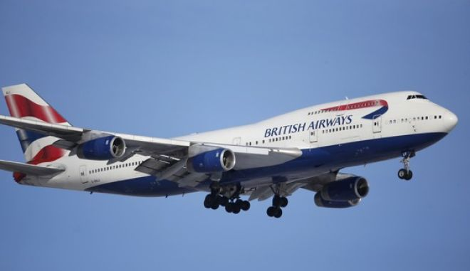 FILE -- In this Feb. 8, 2016 file photo, a British Airways plane lands on a runway at Denver International Airport. British Airways has apologized for delays caused by computer glitches in check-in systems  and warned that there may be further troubles. (AP Photo/David Zalubowski, File)