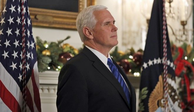 Vice President Mike Pence listens as President Donald Trump speaks in the Diplomatic Reception Room of the White House, Wednesday, Dec. 6, 2017, in Washington. Trump recognized Jerusalem as Israel's capital despite intense Arab, Muslim and European opposition to a move that would upend decades of U.S. policy and risk potentially violent protests. (AP Photo/Alex Brandon)