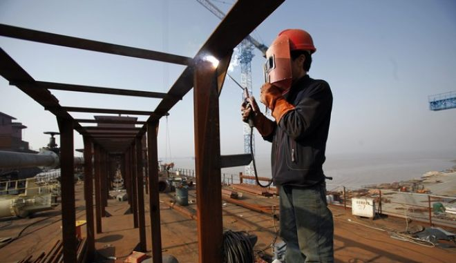 A labourer works at a shipyard in Yueqing City, Zhejiang Province March 27, 2012. China's industrial firms made total profits of 606 billion yuan ($96 billion) in the first two months of 2012, down 5.2 percent from the same period last year, the National Bureau of Statistics said on Tuesday.   REUTERS/Carlos Barria  (CHINA - Tags: BUSINESS INDUSTRIAL)