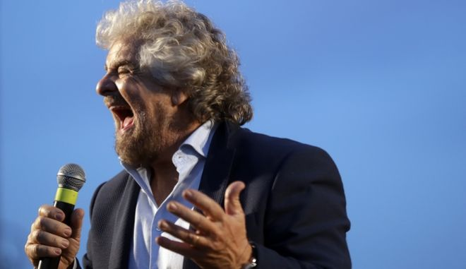 FILE - In this Saturday, Nov. 26, 2016 file photo, Five Stars Movement party's Beppe Grillo,speaks at a rally on the upcoming constitutional reforms referendum, in Rome. Italians will be called on Dec. 4 to vote, in a referendum proposed by Matteo Renzi's government, over a reform that if approved will change the country's Constitution adopted in 1947. A yes-or-no referendum Sunday on government-championed constitutional reforms has been transformed by rivals into a virtual plebiscite on the 41-year-old leader, Italys youngest. A win by the No camp would be expected to trigger Renzis resignation. (AP Photo/Gregorio Borgia, File)