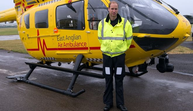 Britain's Prince William, the Duke of Cambridge poses in front of  an East Anglian Air Ambulance (EAAA)  as he begins his new role,  at Cambridge Airport, Cambridge, in England,  Monday July 13, 2015. Prince William says he's nervous but looking forward to getting started as he begins working as an air ambulance pilot based at Cambridge Airport. The second-in-line to Britain's throne clocked in Monday for his first shift for East Anglian Air Ambulance and checked over his H145 helicopter, together with his crewmates. (Stefan Rousseau, Pool Photo via AP)