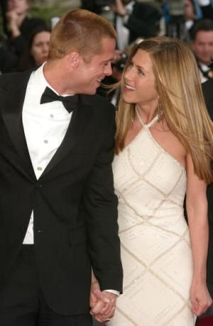 CANNES, FRANCE - MAY 13:  Actor Brad Pitt and wife actress Jennifer Aniston attend the World Premiere of the epic movie