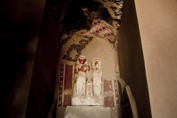 Statues at the entrance of the New Kingdom tomb that belongs to a royal goldsmith in a burial shaft during a press conference on site, in Luxor, Egypt, Saturday, Sept. 9, 2017. El-Anany said the tomb is not in good condition, but it contains a statue of the goldsmith and his wife as well as a funerary mask. He said a shaft in the tomb contained mummies belonging to ancient Egyptian people who lived during the 21st and 22nd dynasties. (AP Photo/Nariman El-Mofty)