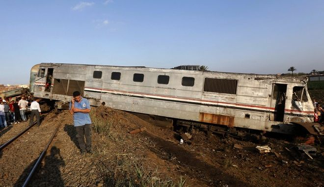 Onlookers gather at the scene of a train collision just outside Egypts Mediterranean port city of Alexandria, Friday, Aug. 11, 2017, two trains collided killing dozens of people and injuring over 100 in the countrys deadliest rail accident in more than a decade. (AP Photo/Ravy Shaker)