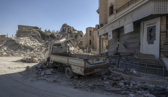 """In this Thursday, Oct. 19, 2017 photo, a heavily destroyed street in Raqqa, Syria. A U.S.-backed Syrian force declared victory over the Islamic State group in its former """"capital"""" of Raqqa on Friday, declaring the northern Syrian city free of any extremist presence.(AP Photo/Gabriel Chaim)"""
