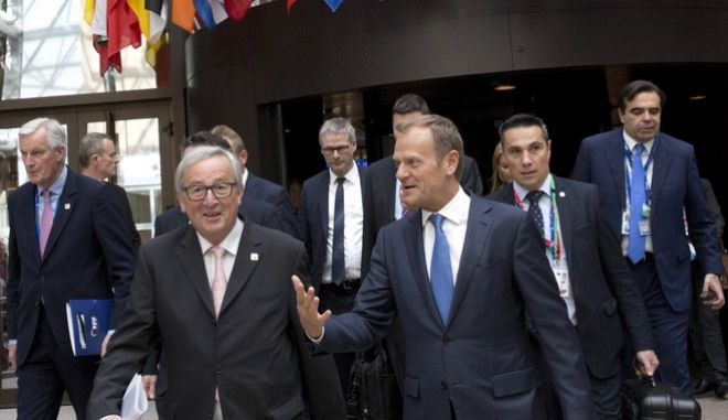 From left, EU Chief Brexit negotiator, Michel Barnier, European Commission President Jean-Claude Juncker and European Council President Donald Tusk make their way to a media conference at an EU summit in Brussels on Saturday, April 29, 2017. EU leaders met on Saturday for the first time as the formal European Council of 27 to adopt guidelines for the upcoming Brexit negotiations. (AP Photo/Virginia Mayo)