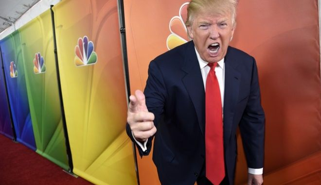 """FILE - In this Jan. 16, 2015 file photo, Donald Trump, host of the television series """"The Celebrity Apprentice,"""" mugs for photographers at the NBC 2015 Winter TCA Press Tour in Pasadena, Calif. The skyline shimmers, the music pulses and Donald Trumps helicopter swoops in for a landing. Oozing authority, the billionaire strides purposefully, in slow-motion, for added impact, toward some important matter of business in New York, my city, as Trump calls it. Week by week, year by year, 14 seasons of The Apprentice or Celebrity Apprentice served as a grand homage to all things Trump, running from 2004 to 2015.  (Photo by Chris Pizzello/Invision via AP, File)"""
