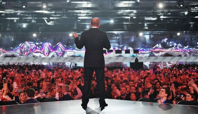 """Russian President Vladimir Putin gestures while speaking at a youth forum """"Russia, Land of Opportunity"""" in Moscow, Russia, Thursday, March 15, 2018. (Alexei Druzhinin, Sputnik, Kremlin Pool Photo via AP)"""