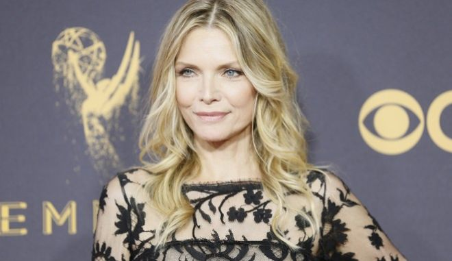 Michelle Pfeiffer arrives at the 69th Primetime Emmy Awards on Sunday, Sept. 17, 2017, at the Microsoft Theater in Los Angeles. (Photo by Danny Moloshok/Invision for the Television Academy/AP Images)