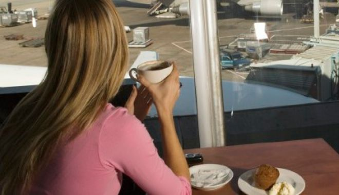 Two Woman at an Airport Restaurant Waiting for Flights