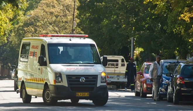 An ambulance believed to be transporting former president Nelson Mandela arrives at the home of Mandela in Johannesburg, Saturday, April 6, 2013. The South African Presidency has confirmed that  Mandela has been discharged after spending nine days in hospital in Pretoria. Spokesman Mac Maharaj says the elder statesman was discharged, following a sustained and gradual improvement in his general condition, and thanked all South Africans and people around the world for their support. He says Mandela will now receive home based high care. Mandela was admitted to hospital on March 27 with pneumonia. Since then the 94-year-old former statesman has had fluid drained from his lungs to ease his breathing. (AP Photo)