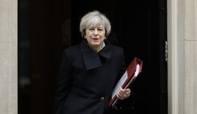 British Prime Minister, Theresa May, leaves 10 Downing Street in London, to attend Prime Minister's Questions at the Houses of Parliament, Wednesday, March 1, 2017. (AP Photo/Matt Dunham)