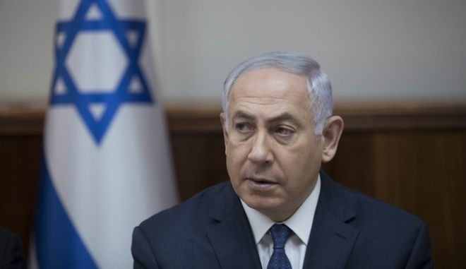 Israeli Prime Minister Benjamin Netanyahu attends the weekly cabinet meeting at his office in Jerusalem, Israel, Sunday, July 23 2017. (Abir Sultan, Pool via AP)