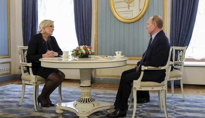 Russian President Vladimir Putin, right, speaks to French far-right presidential candidate Marine Le Pen, in the Kremlin in Moscow, Russia, Friday, March 24, 2017. Le Pen has made multiple visits to Russia, as have her father, niece and other members of the National Front, often meeting with Russian legislators. (Mikhail Klimentyev, Sputnik, Kremlin Pool Photo via AP)